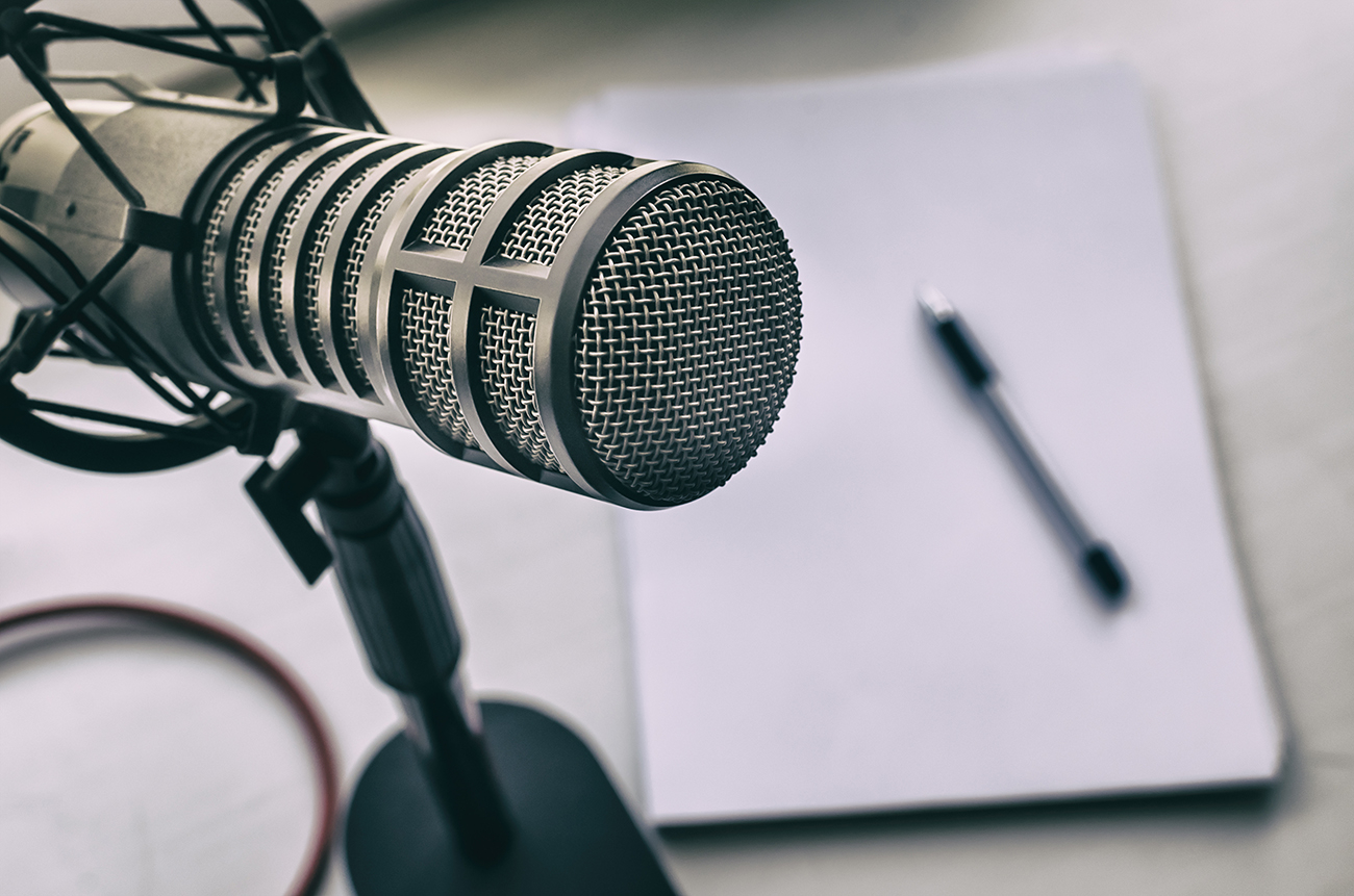 podcast microphone and transcription notepad