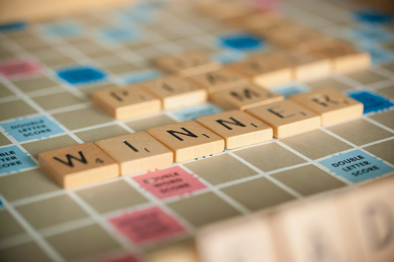 scrabble titles on a game board fftranscription